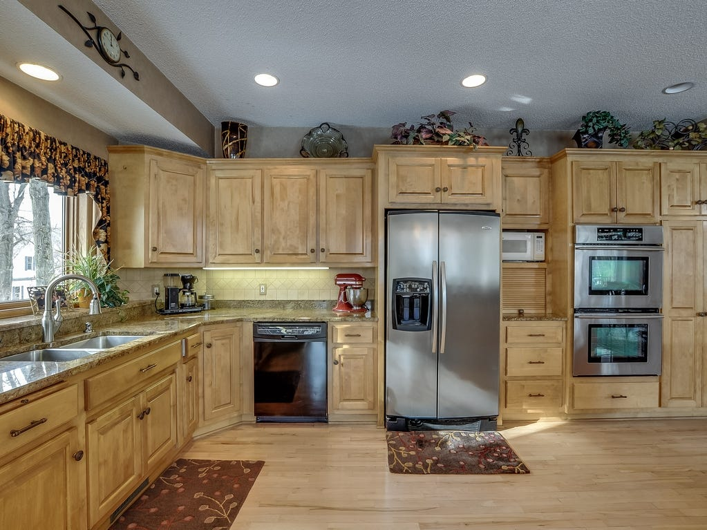 The kitchen has no shortage of attractive storage and is ideally situated to entertain throughout the house.