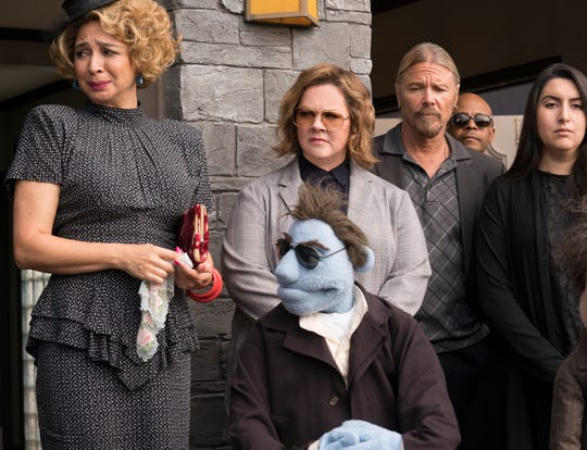 """Melissa McCarthy, center, was in one of best and one of worst films of 2018. This is from the terrible """"The Happytimes Murders."""""""
