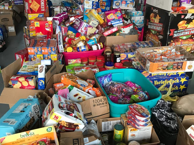 A warehouse filled with donations for Blountstown Hurricane Michael victims. Through social media and word of mouth, the Derzypolskis coordinated an effort to gather donations.