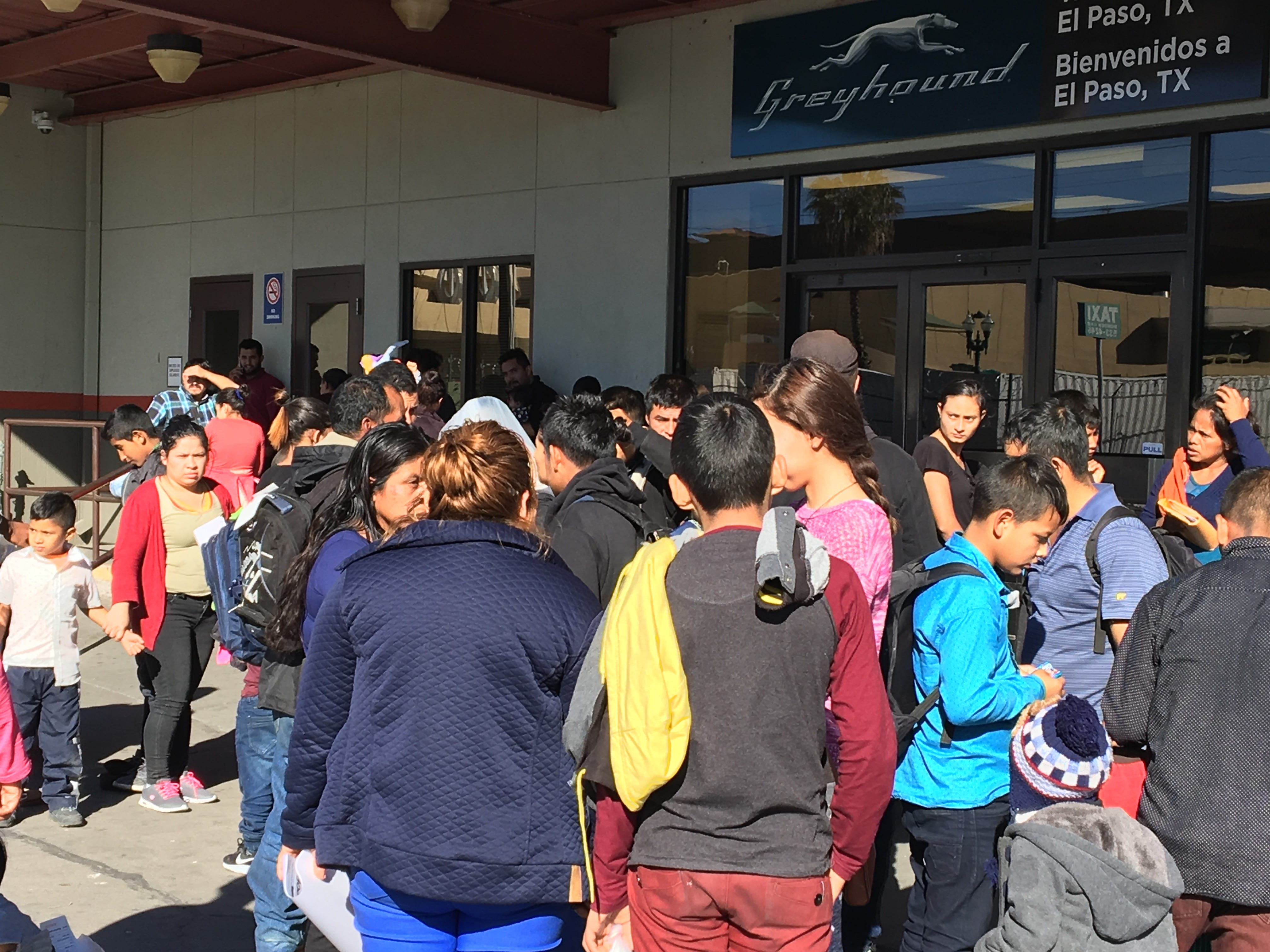 Migrants crowd the Greyhound bus station Monday, Dec. 24, 2018, in Downtown El Paso after they were released by Immigration and Customs Enforcement.
