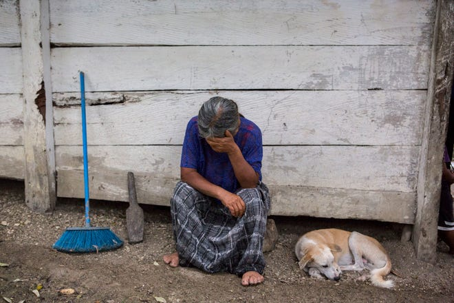 Elvira Choc, 59, Jakelin Amei Rosmery Caal's grandmother, rests her head on her hand in front of her house in Raxruha, Guatemala, on Saturday, Dec. 15, 2018. The 7-year old girl died in a Texas hospital, two days after being taken into custody by border patrol agents in a remote stretch of New Mexico desert.