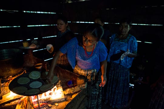 Women make corn tortillas at Jakelin Caal Maquin's grandfather's house in San Antonio Secortez, Guatemala, Sunday, Dec. 23, 2018. The body of Caal Maquin, 7, who died while in custody of the U.S. Border Patrol, arrived in her native Guatemala on Sunday and was driven hours into the countryside to be handed over to family members for a last goodbye.