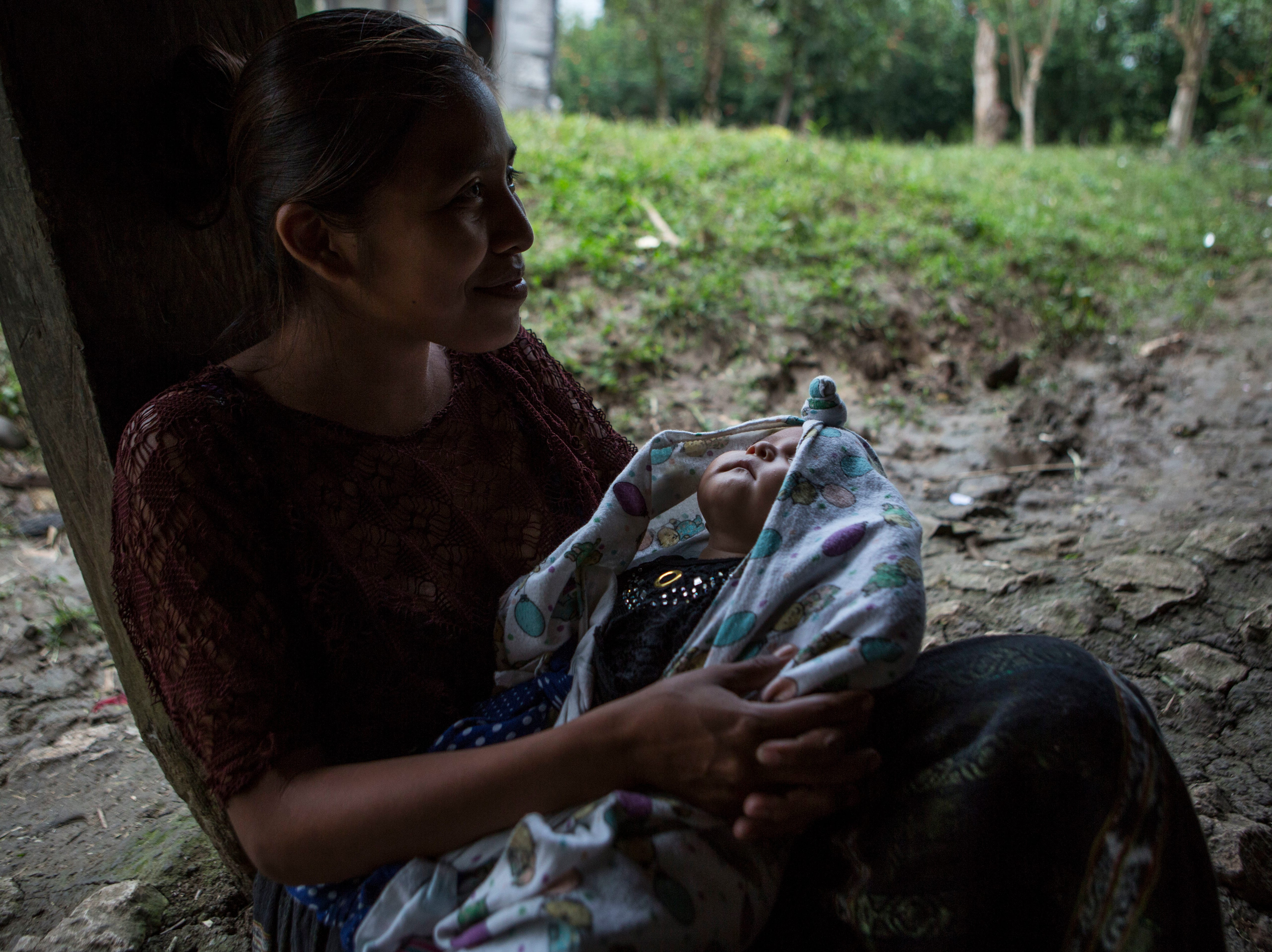 Carmen Esperanza Yatz, 21, holds her 3-month-old daughter Stefany Caal as they wait for the remains of Jakelin Caal Maquin in San Antonio Secortez, Guatemala, Sunday, Dec. 23, 2018. The body of Caal Maquin, 7, who died while in custody of the U.S. Border Patrol, arrived in her native Guatemala on Sunday and was driven hours into the countryside to be handed over to family members for a last goodbye.