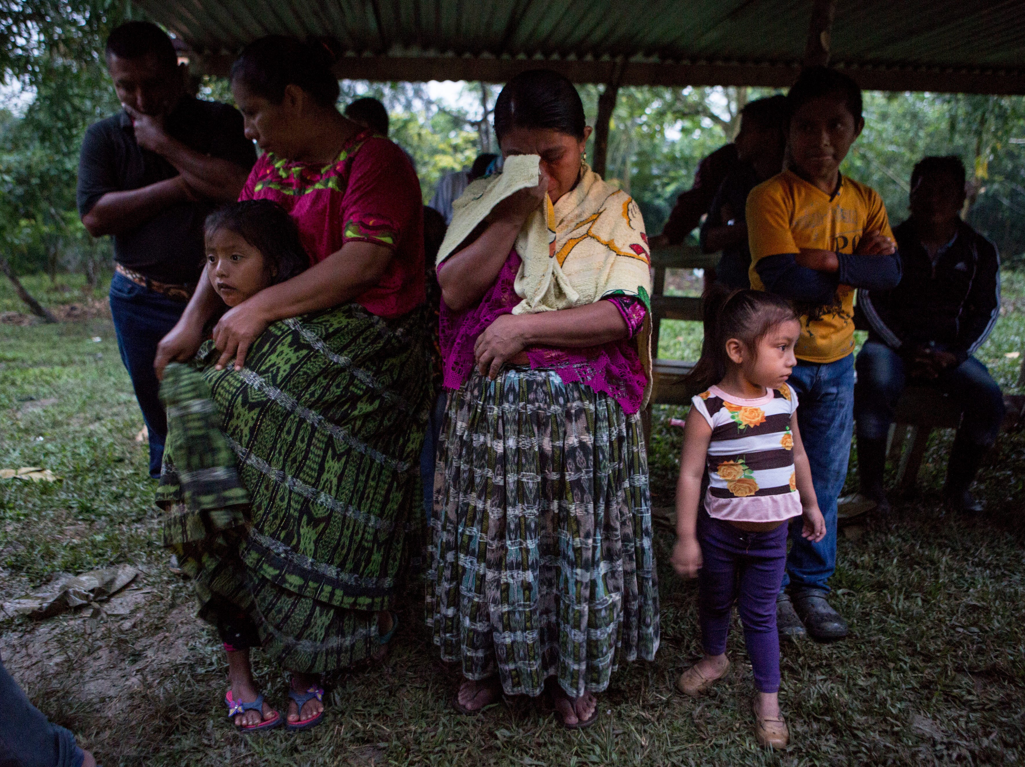 Family members attend a memorial service for 7-year-old granddaughter Jakelin Caal Maquin, in San Antonio Secortez, Guatemala, Monday, Dec. 24, 2018. The body of the 7-year-old girl who died while in the custody of the U.S. Border Patrol was handed over to family members in her native Guatemala on Monday for a last goodbye.