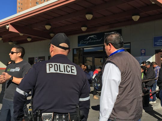 El Paso police keep watch after a group of more than 50 migrants were released by ICE on Christmas Eve afternoon at the Greyhound bus station in Downtown El Paso. The release followed 200 migrants being released Sunday night. More were expected Christmas Day.