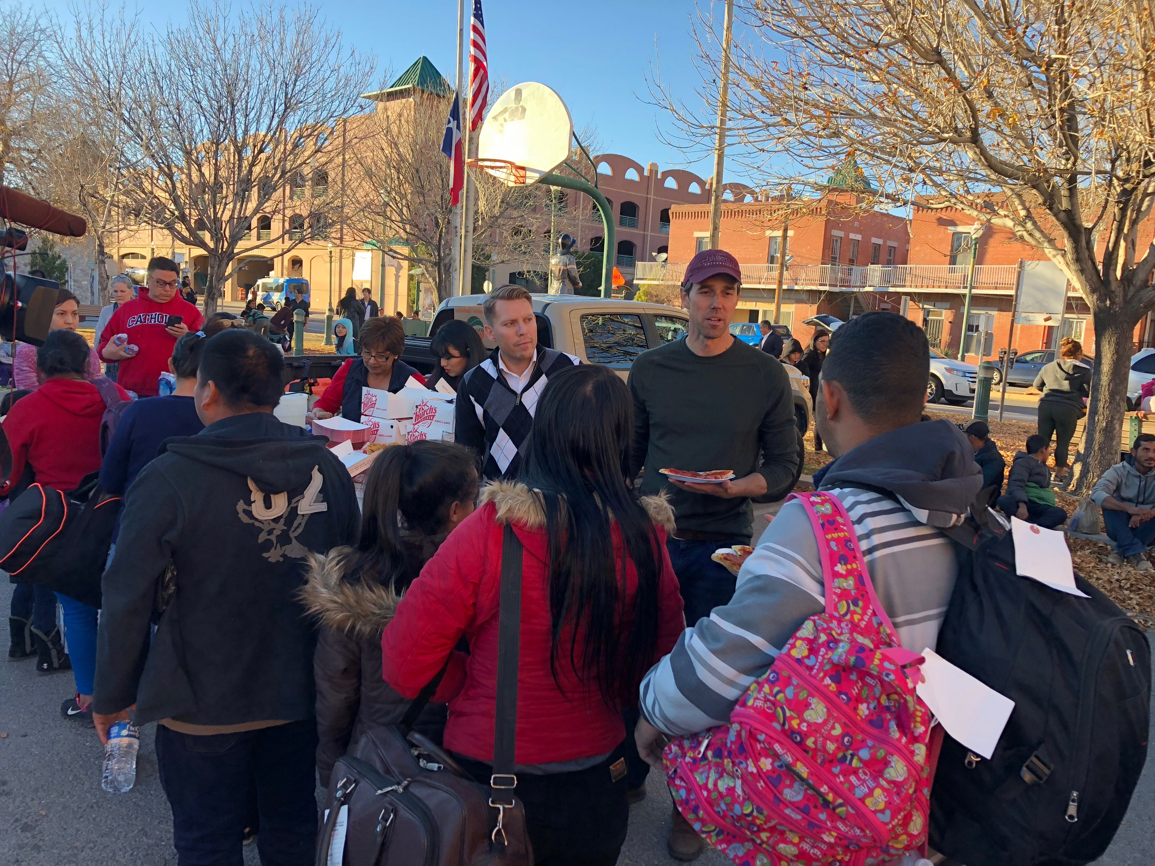 U.S. Rep. Beto O'Rourke, right, and El Paso County Judge Ruben Vogt passed out supplies to migrants who were dropped off in Downtown El Paso.