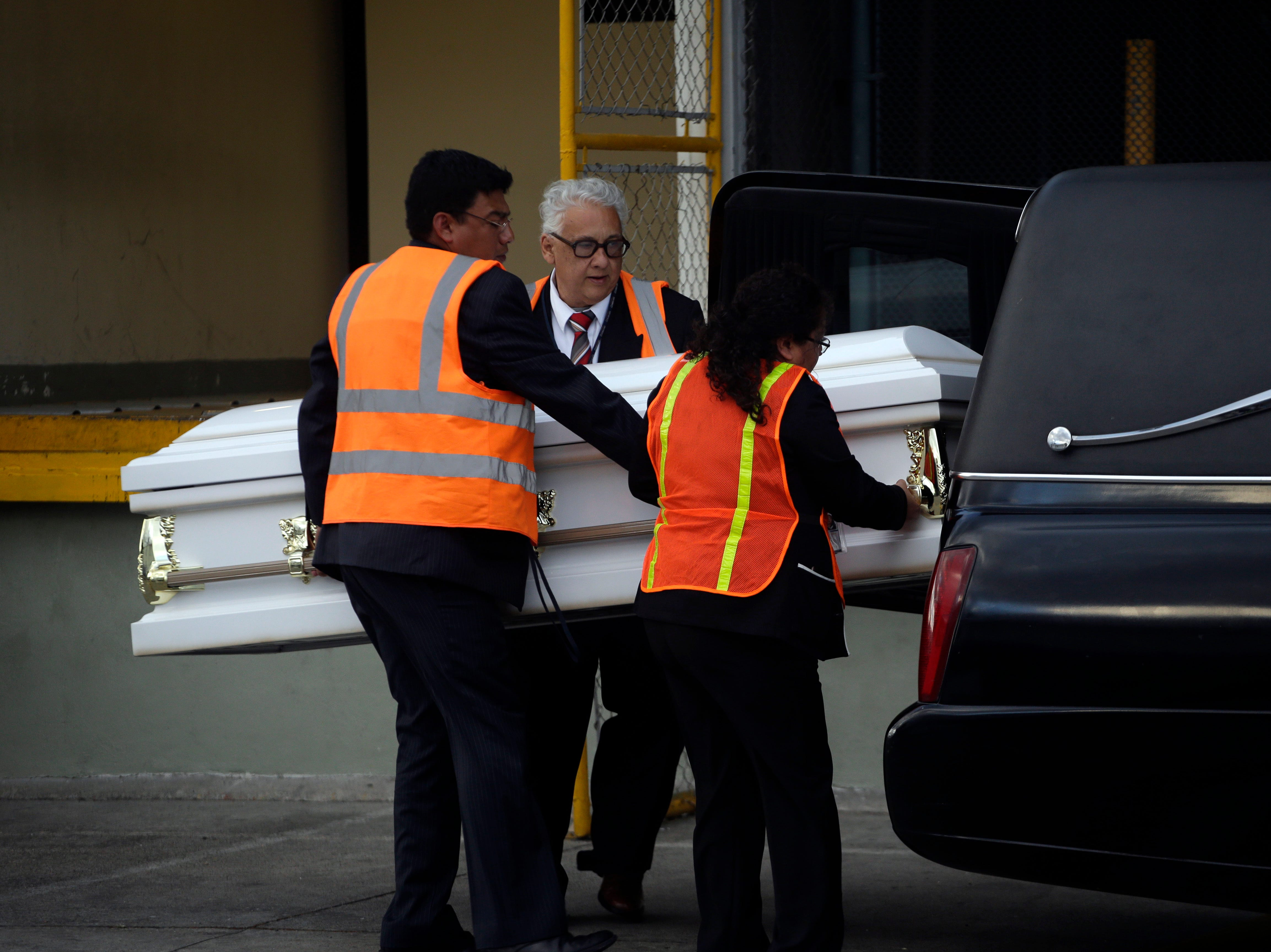 Mortuary employees carry the body of Jakelin Caal Maquin after her remains were repatriated to Guatemala, at La Aurora International Airport in Guatemala City, Sunday, Dec. 23, 2018. Caal Maquin, 7, died in a Texas hospital two days after being taken into custody by U.S. Border Patrol agents in a remote stretch of New Mexico desert.