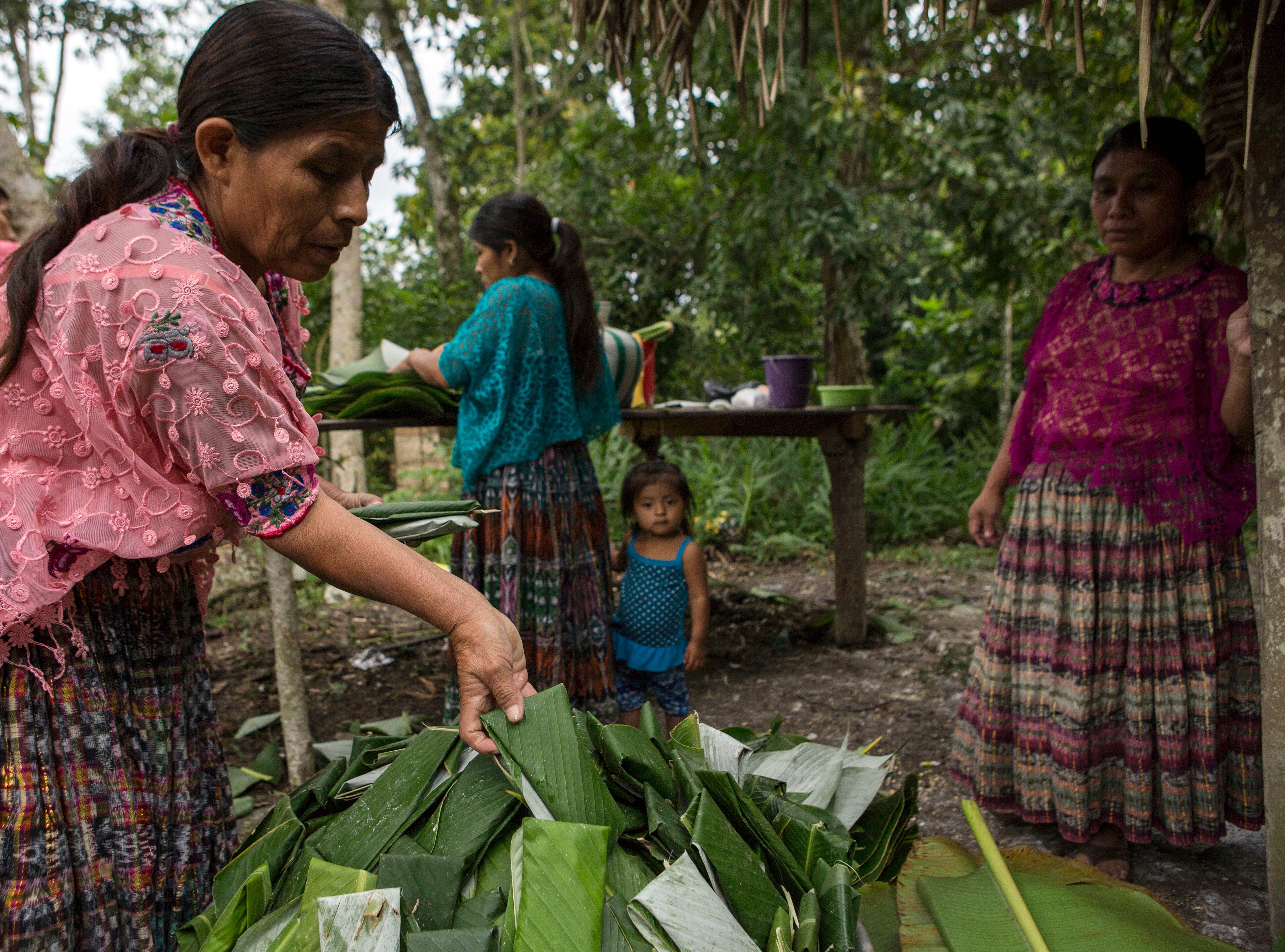Women cook tamales for the relatives and neighbors who attend the funeral for Jakelin Caal Maquin, in San Antonio Secortez, Guatemala, Sunday, Dec. 23, 2018. The body of Caal Maquin, 7, who died while in custody of the U.S. Border Patrol, arrived in her native Guatemala on Sunday and was driven hours into the countryside to be handed over to family members for a last goodbye.