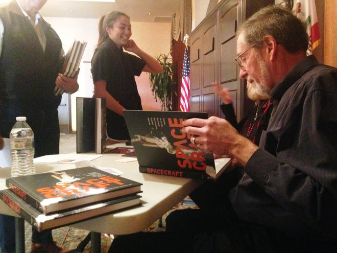 """Thousand Oaks resident Michael H. Gorn, an author and historian specializing in the field of aeronautics and space flight, signs his book, """"Space Craft: 100 Iconic Rockets, Shuttles, and Satellites That Put Us in Space,"""" at the Camarillo Public Library."""