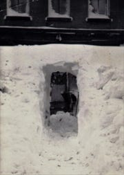 Here's a photo of someone digging out in downtown Hurley after the 1938 snowstorm.