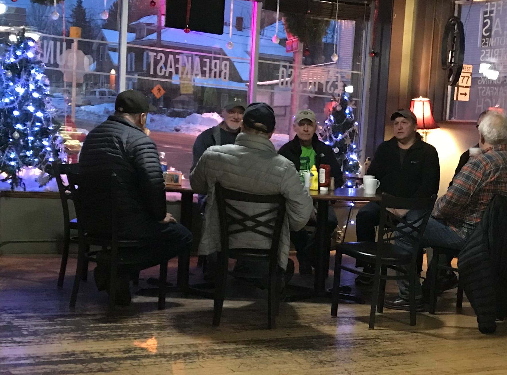 "Residents also embrace the Danish concept of ""hygge"" or coziness and contentment, to get through long, snowy winters. Here a group of men enjoy some early morning coffee and conversation at Sharon's Coffee Company in downtown Hurley."