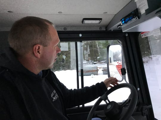 "Scott Czerneski, 48, of Hurley makes his living as a letter carrier for the U.S. Postal Service. He's out in the snow every single day, and on his days off, he volunteers as a snowmobile trail groomer. ""I love it here,"" he said."
