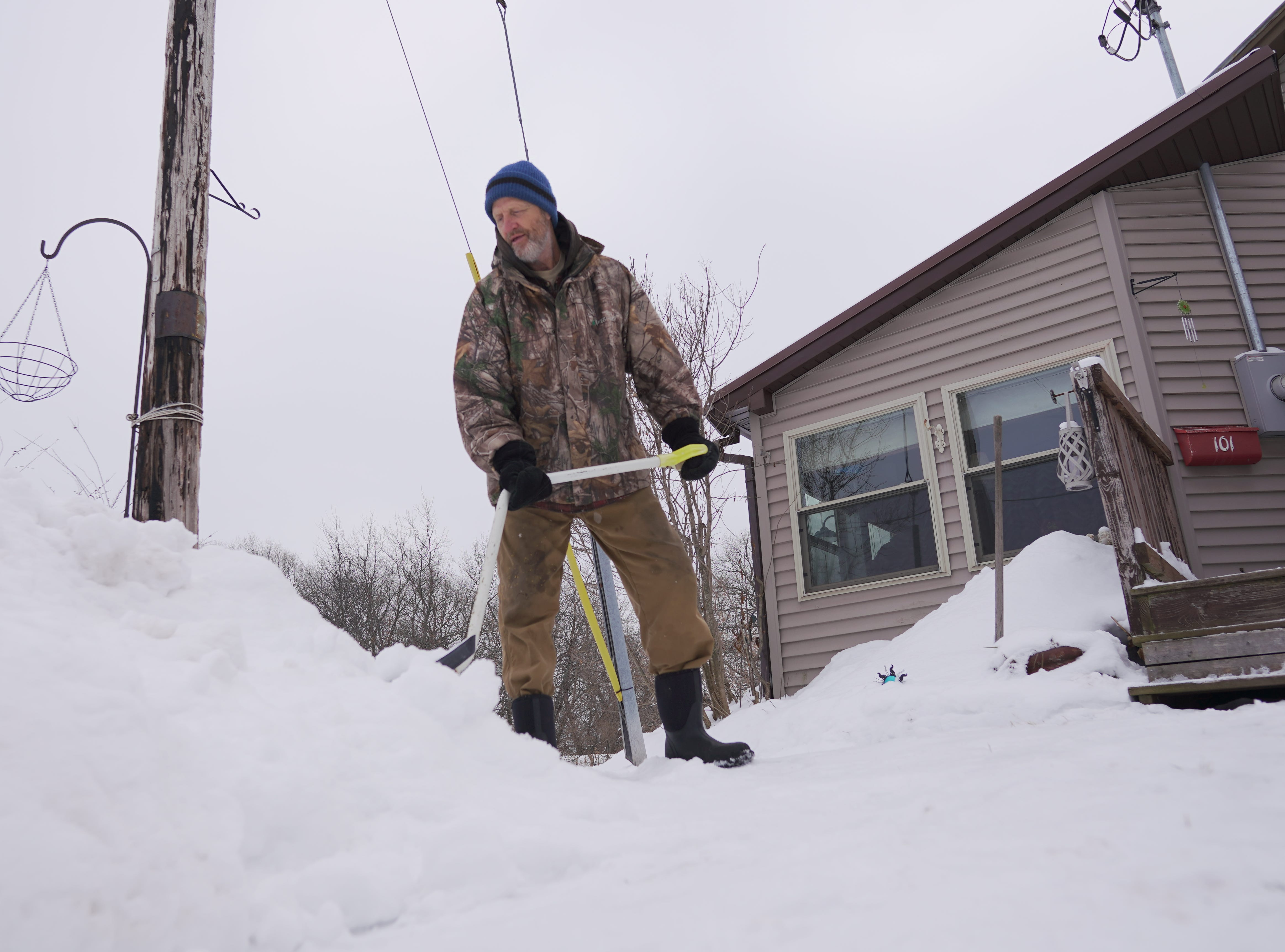 "Matt King, 62, removes some of the snow from the front area of his Hurley home. ""I like shoveling,"" he said. ""It gives me something to do, gets me out of the house."