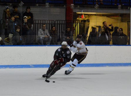 Fordham Prep's Jack Greco (11) controls the puck and sets up a move on net in the third period of a 4-2 win over Iona Prep on Sunday, Dec. 23, 2018 at Playland Ice Casino.