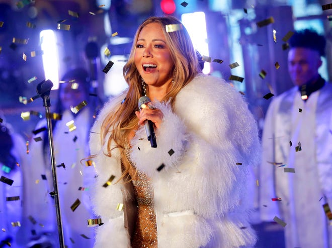 In this Dec. 31, 2017, file photo, Mariah Carey performs at the New Year's Eve celebration in Times Square in New York.