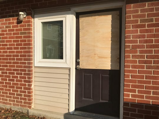 A bullet shattered the glass of a door window at the Brightway Commons apartment complex.