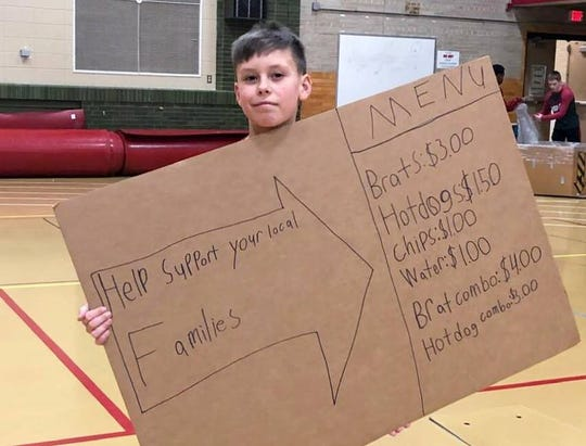Wrestlers sold brats, hot dogs and more to help a local family during the holidays.