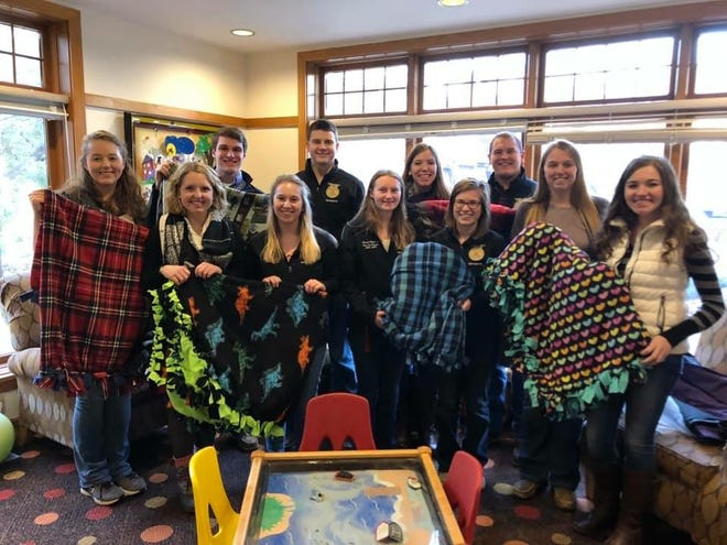 Members of the Wisconsin FFA officer team donates tied blankets to the Ronald McDonald House in Madison.