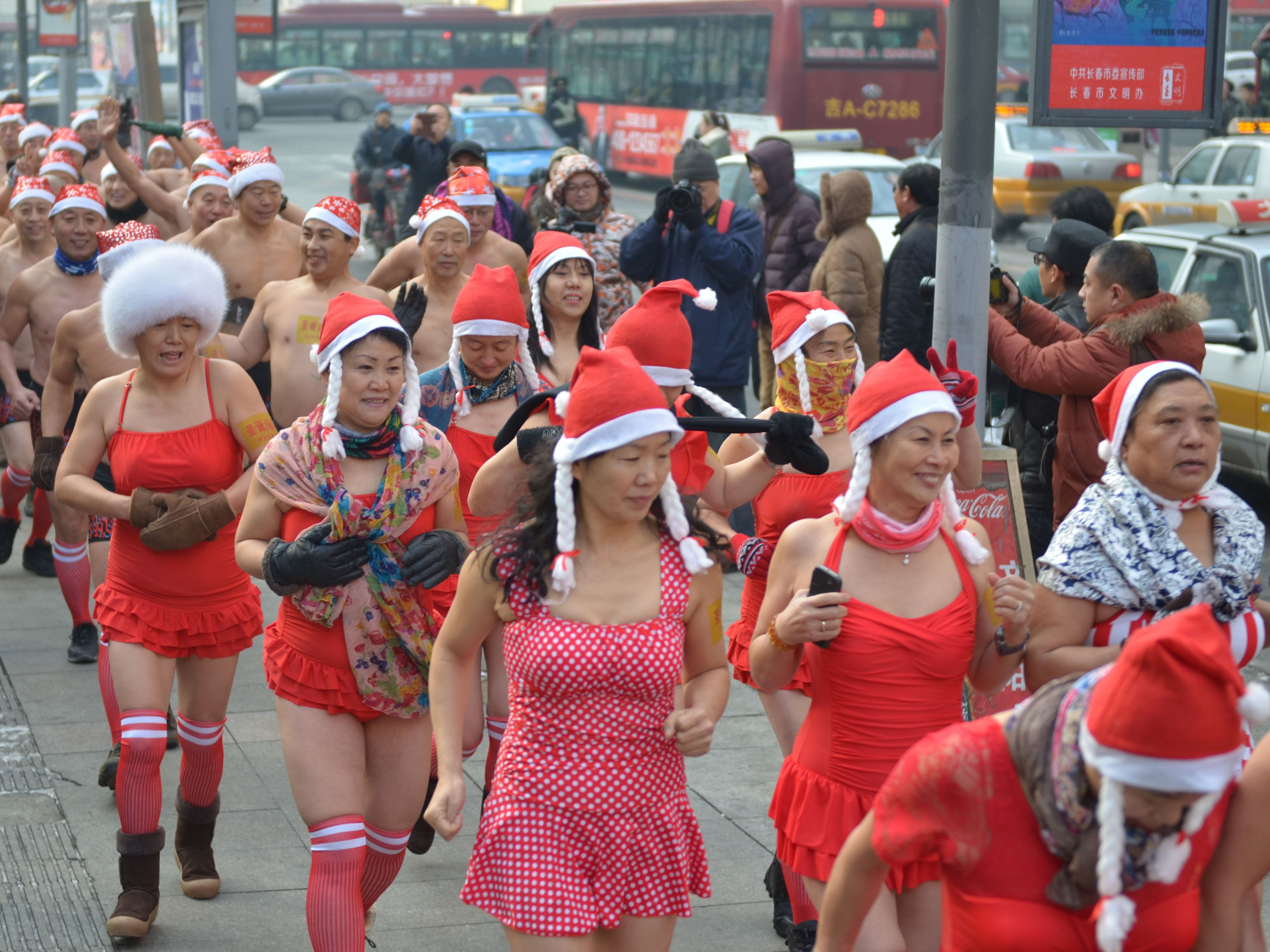 This photo taken on December 23, 2018 shows winter swimming enthusiasts wearing Santa hats attending a running event at temperatures of minus 21 degrees Celsius (-6 F) in Shenyang in China's northeastern Liaoning province, to promote benefits of winter swimming. (Photo by STR / AFP) / China OUTSTR/AFP/Getty Images ORIG FILE ID: AFP_1BT37Z