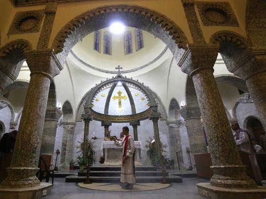 An Iraqi priest celebrates a Mass at the Church of Saint John in the Nineveh province of Iraq.