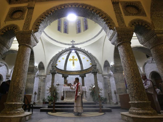 An Iraqi priest celebrates a Mass at the Church of Saint John in the Nineveh province of Iraq.