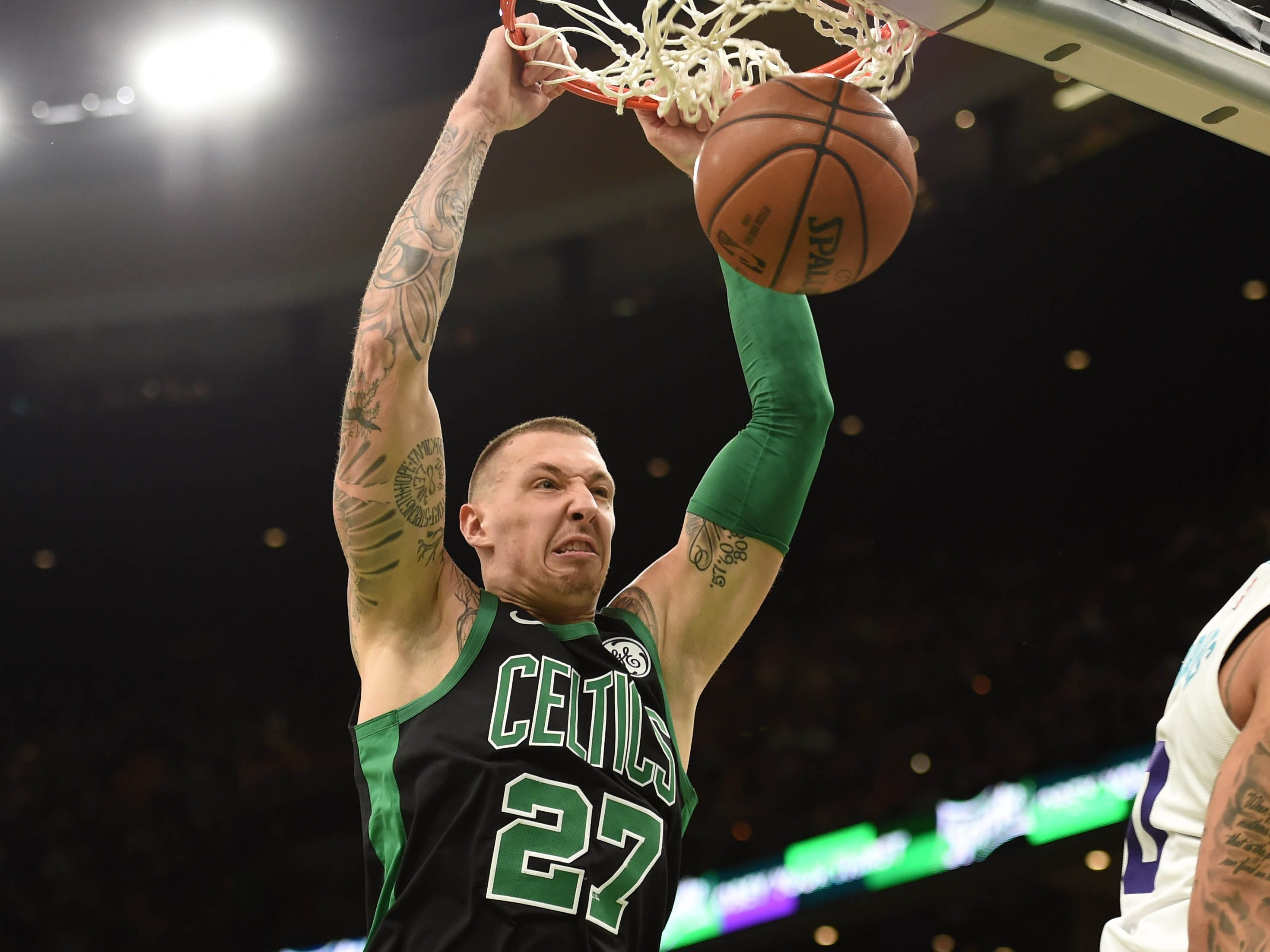 Dec. 23: Celtics forward Daniel Theis throws it down with a scowl during the second half against the Hornets in Boston.