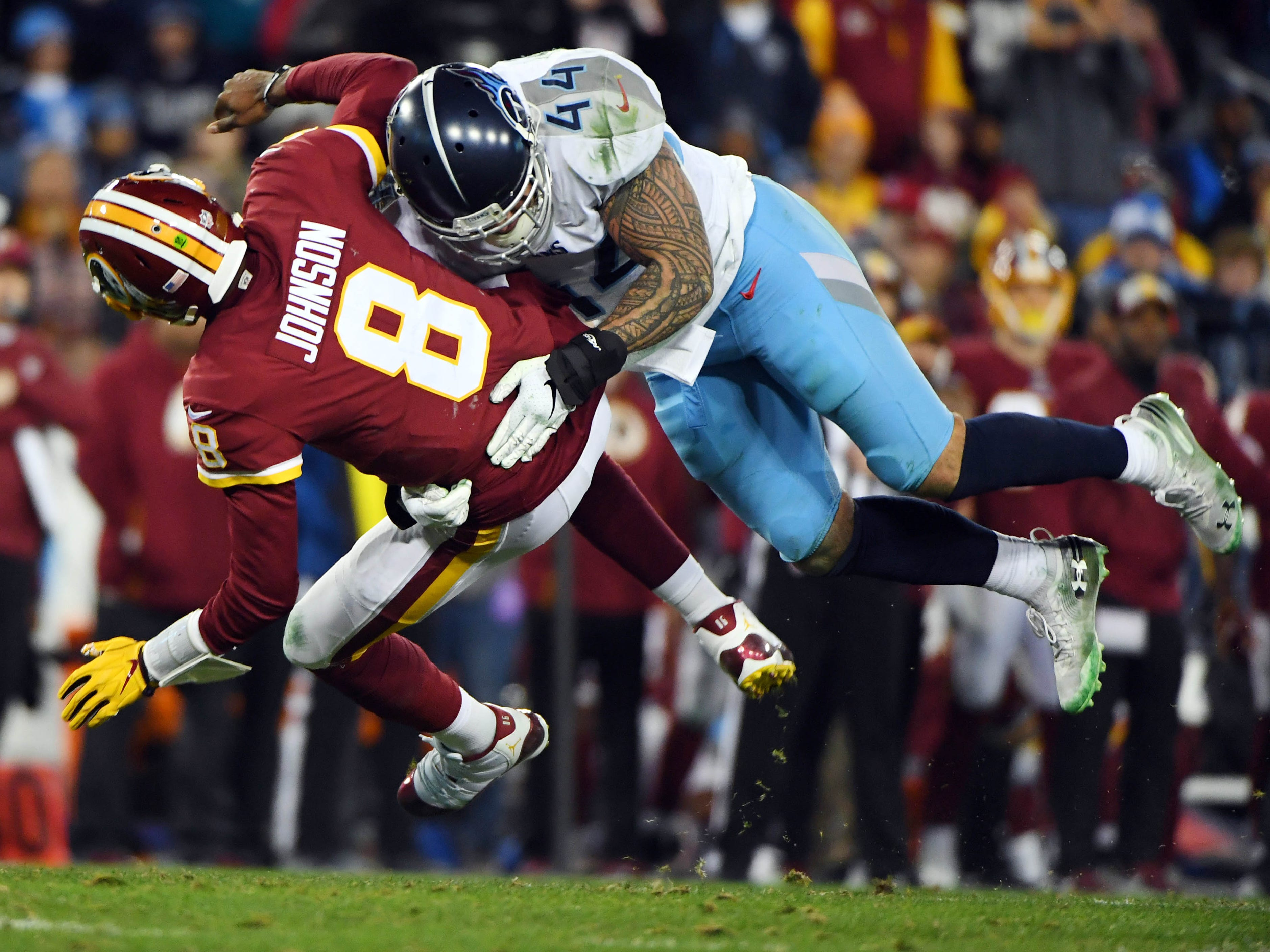 Week 16: Washington Redskins quarterback Josh Johnson is hit by Tennessee Titans outside linebacker Kamalei Correa after a pass during the second half at Nissan Stadium. The Titans won the game, 25-16.