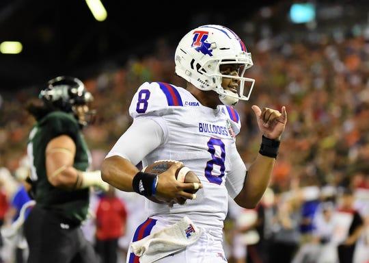 Louisiana Tech Bulldogs quarterback J'Mar Smith (8) scores a touchdown against the Hawaii Warriors during the third quarter of the Hawaii Bowl.
