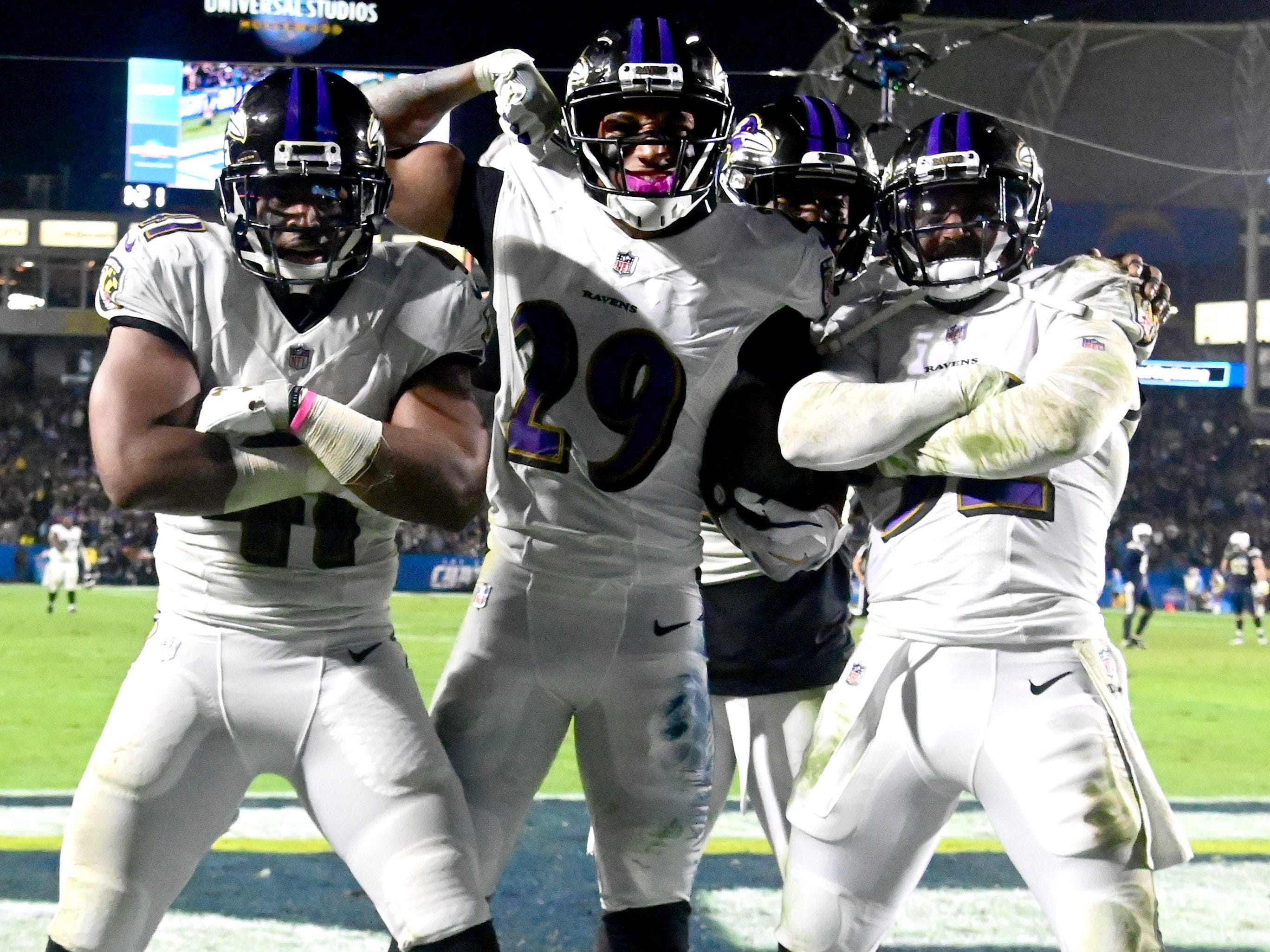 Baltimore Ravens cornerback Marlon Humphrey (29) celebrates with defensive back Anthony Levine (41), strong safety Tony Jefferson (23) and free safety Eric Weddle (32) after intercepting a pass in the fourth quarter against the Los Angeles Chargers  at StubHub Center.