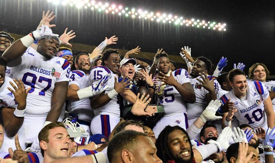 The Louisiana Tech Bulldogs celebrate after defeating the Hawaii Warriors in the Hawaii Bowl, their fifth straight bowl victory.