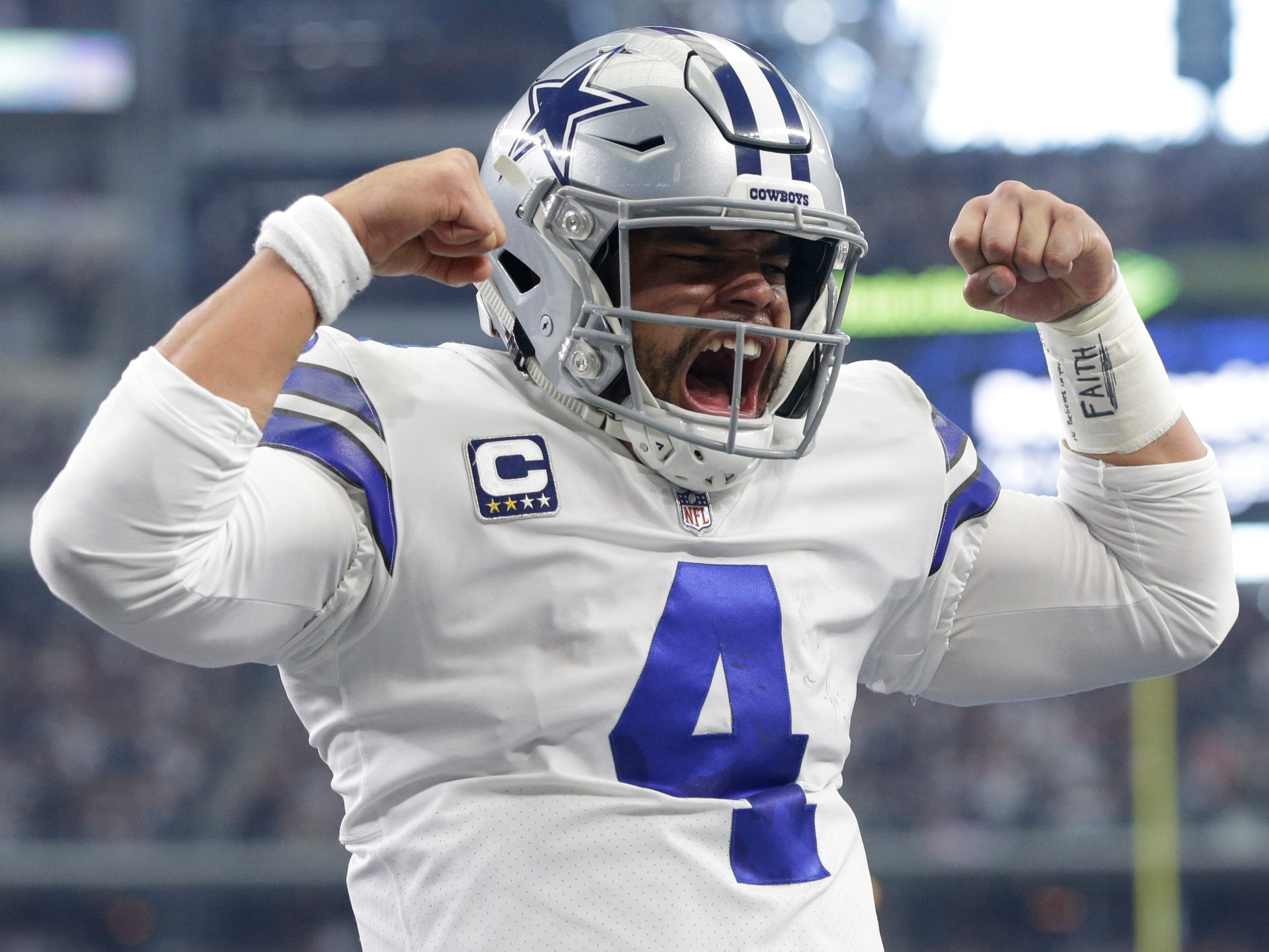Week 16: Dallas Cowboys quarterback Dak Prescott reacts after running for a  touchdown against the Tampa Bay Buccaneers at AT&T Stadium. The Cowboys won the game, 27-20.