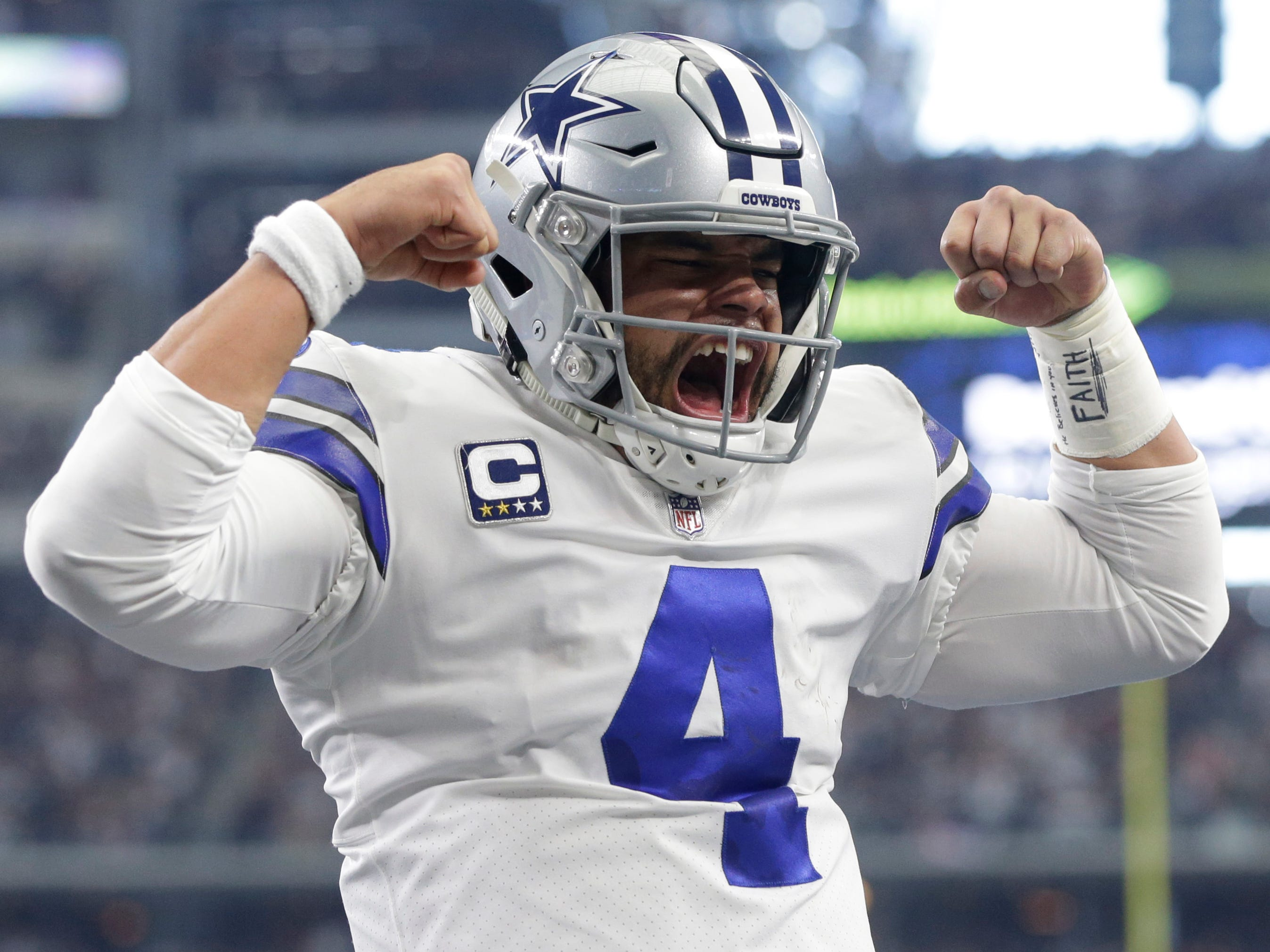 Dallas Cowboys quarterback Dak Prescott reacts after running for a 7-yard touchdown in the first quarter against the Tampa Bay Buccaneers  at AT&T Stadium.