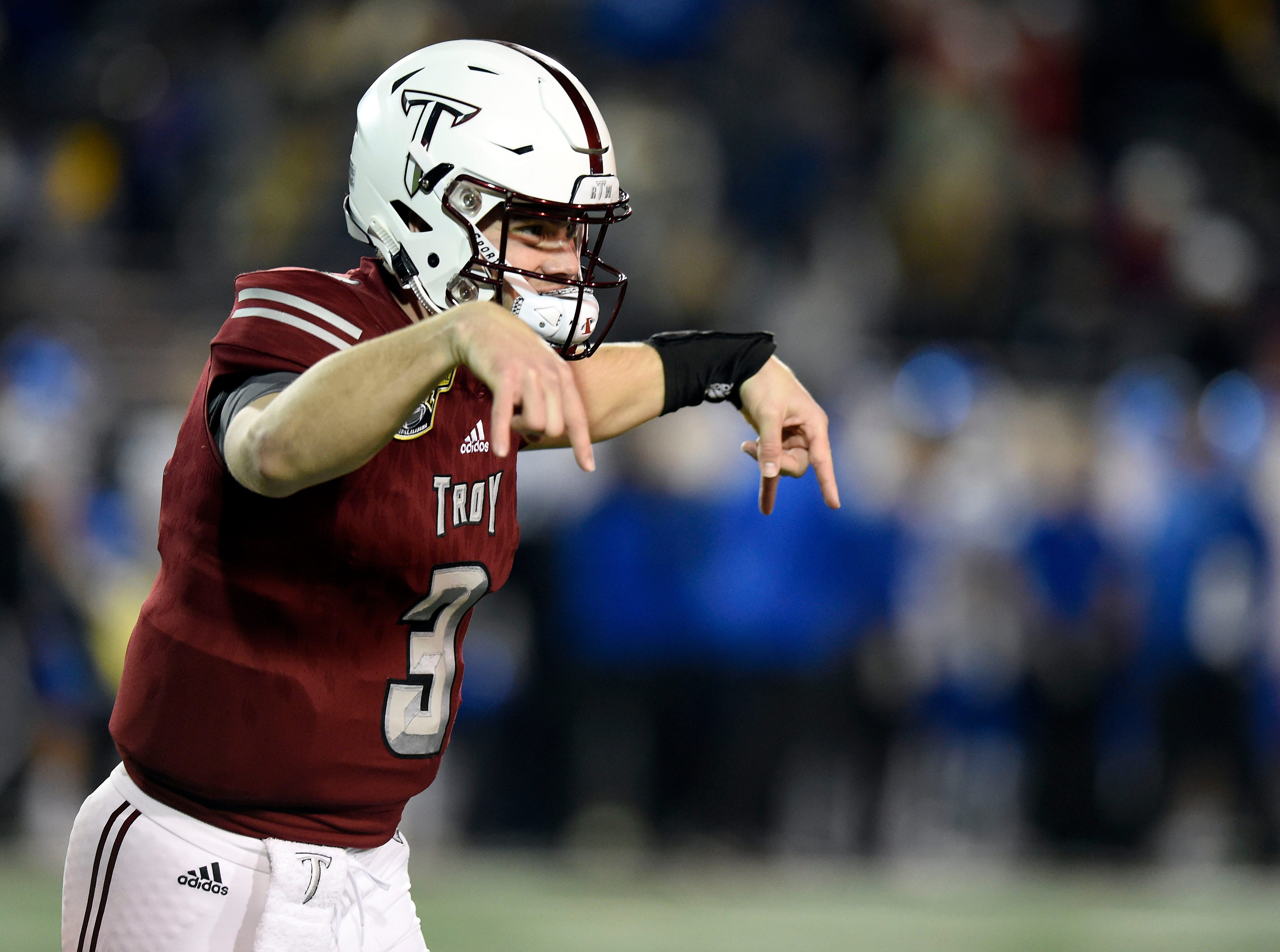 Troy Trojans quarterback Sawyer Smith (3) celebrates his touchdown  pass against the Buffalo Bulls during the first quarter of the Dollar General Bowl.