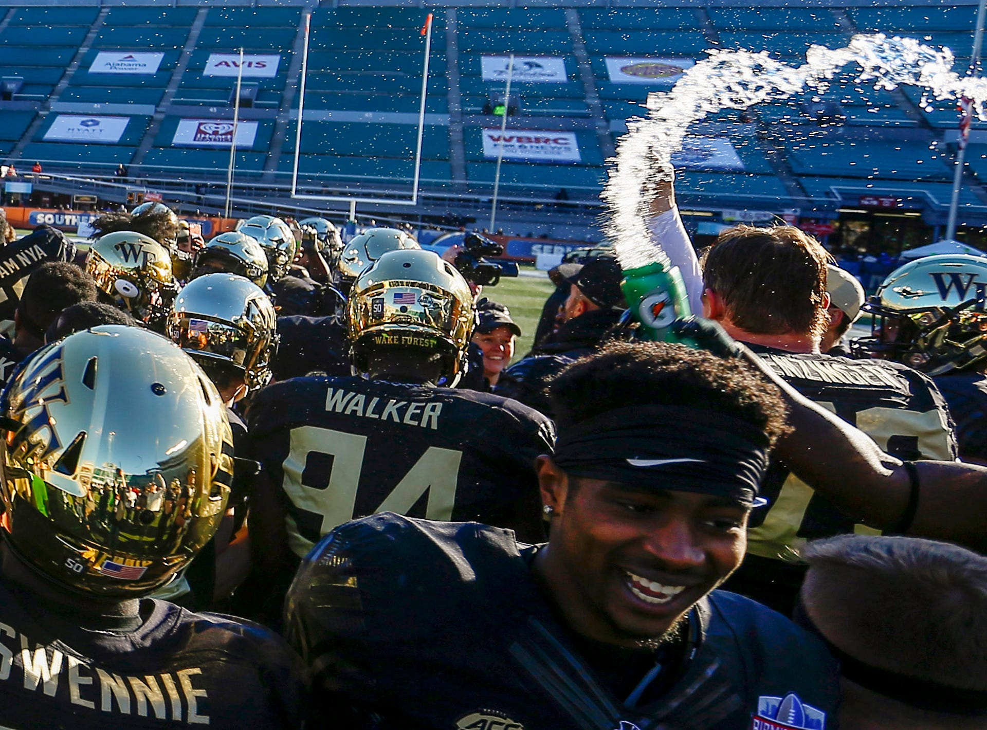A Wake Forest Demon Deacons player tosses Gatorade in celebration after the win over the Memphis Tigers in the Birmingham Bowl.