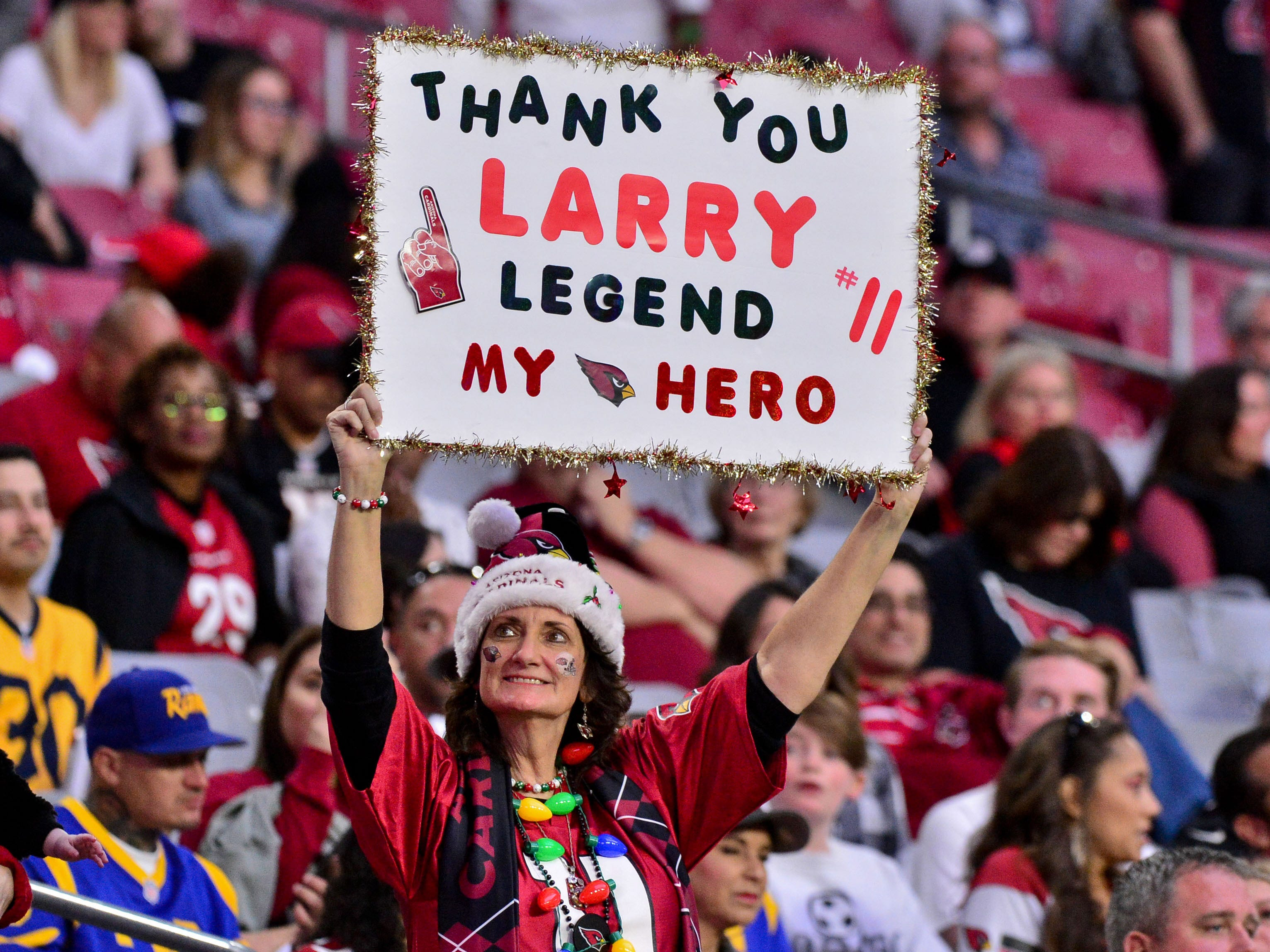 A Arizona Cardinals fan holds a sign during the second half against the Los Angeles Rams at State Farm Stadium.