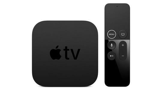 Apple TV box and remote.