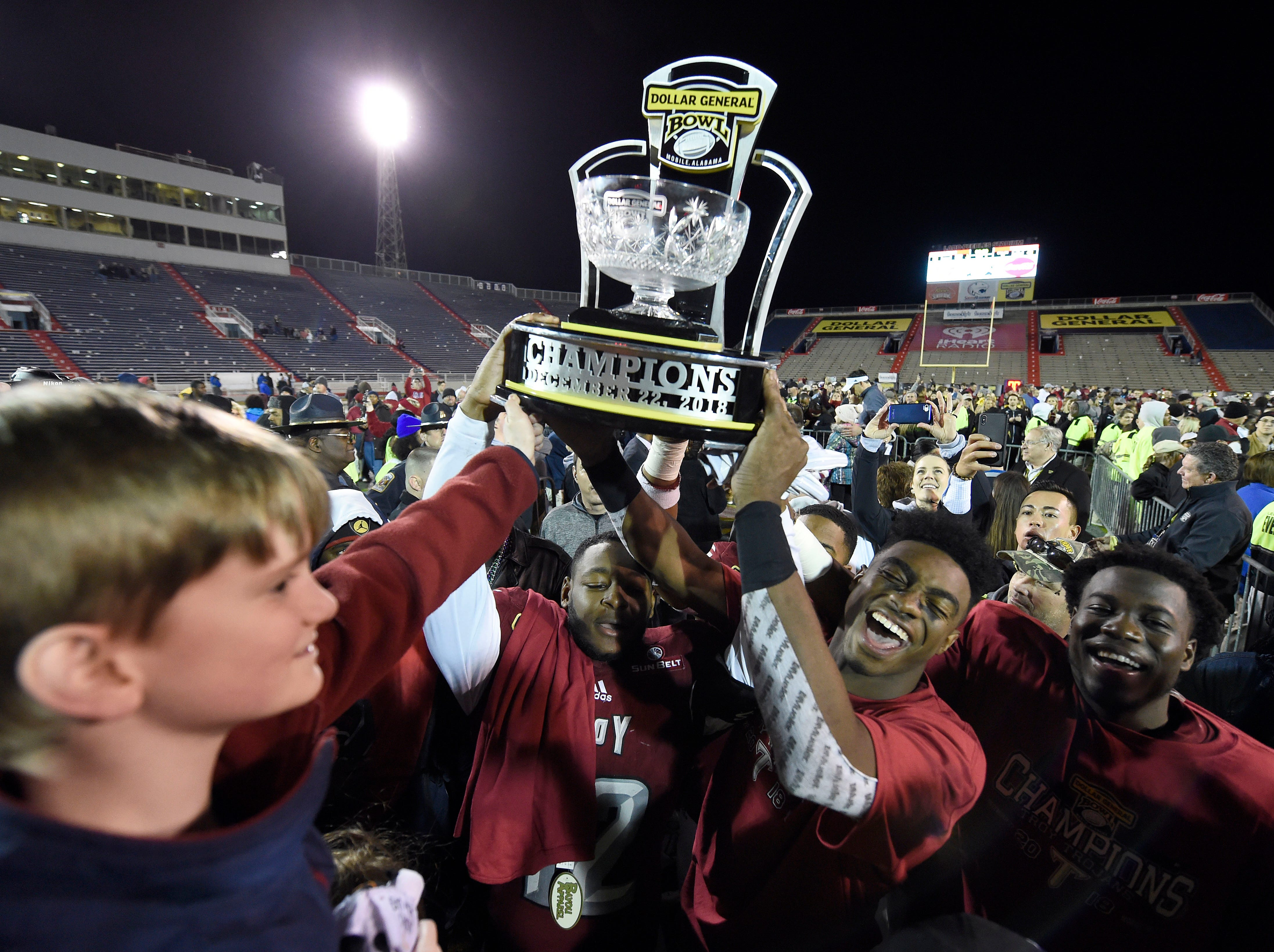 The Troy Trojans celebrate their victory over the Buffalo Bulls in the Dollar General Bowl.
