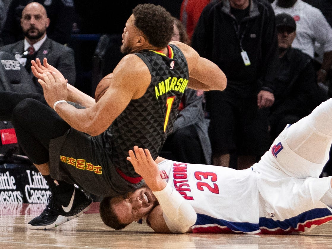 Dec. 23: Hawks guard Justin Anderson falls on Pistons forward Blake Griffin's during a first-half scramble in Detroit.