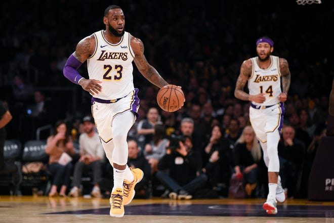 Los Angeles Lakers forward LeBron James (23) moves the ball up the court during the third quarter against the Memphis Grizzlies at Staples Center.