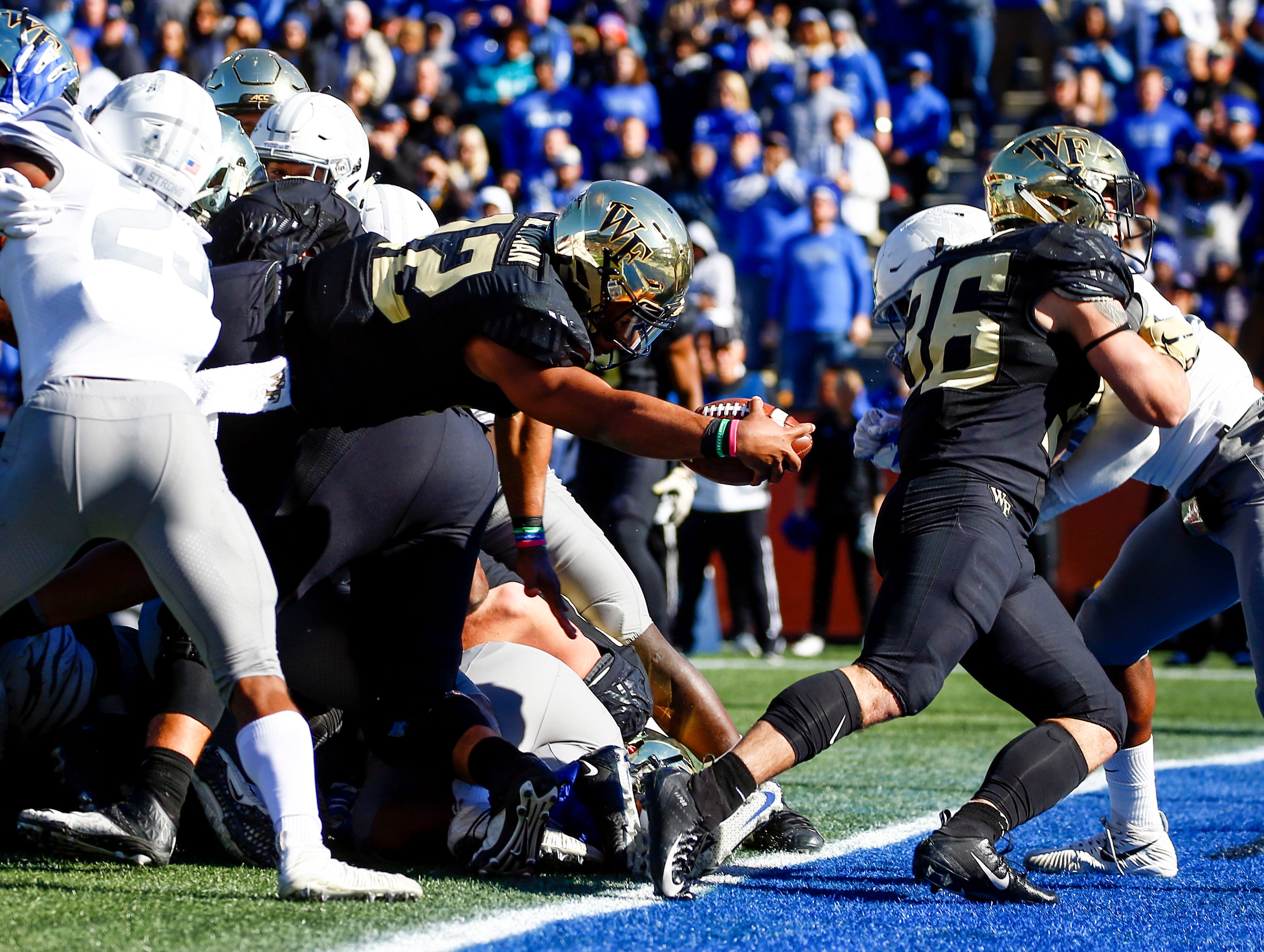 Wake Forest Demon Deacons quarterback Jamie Newman (12) dives for a touchdown during the first half of the Birmingham Bowl.