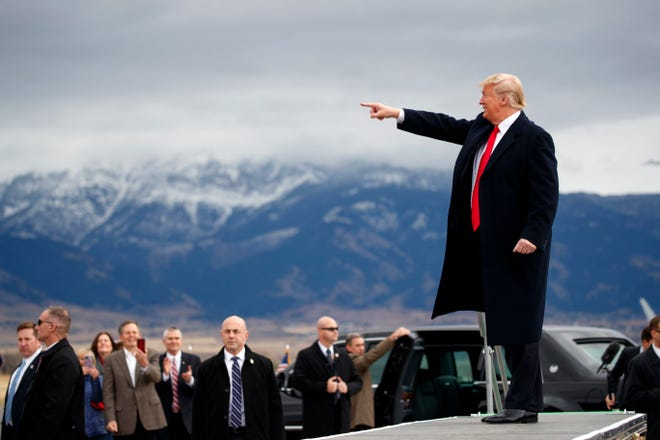 FILE - In this Nov. 3, 2018, file photo, President Donald Trump arrives for a campaign rally at Bozeman Yellowstone International Airport in Belgrade, Mont. (AP Photo/Evan Vucci, File) ORG XMIT: WX108