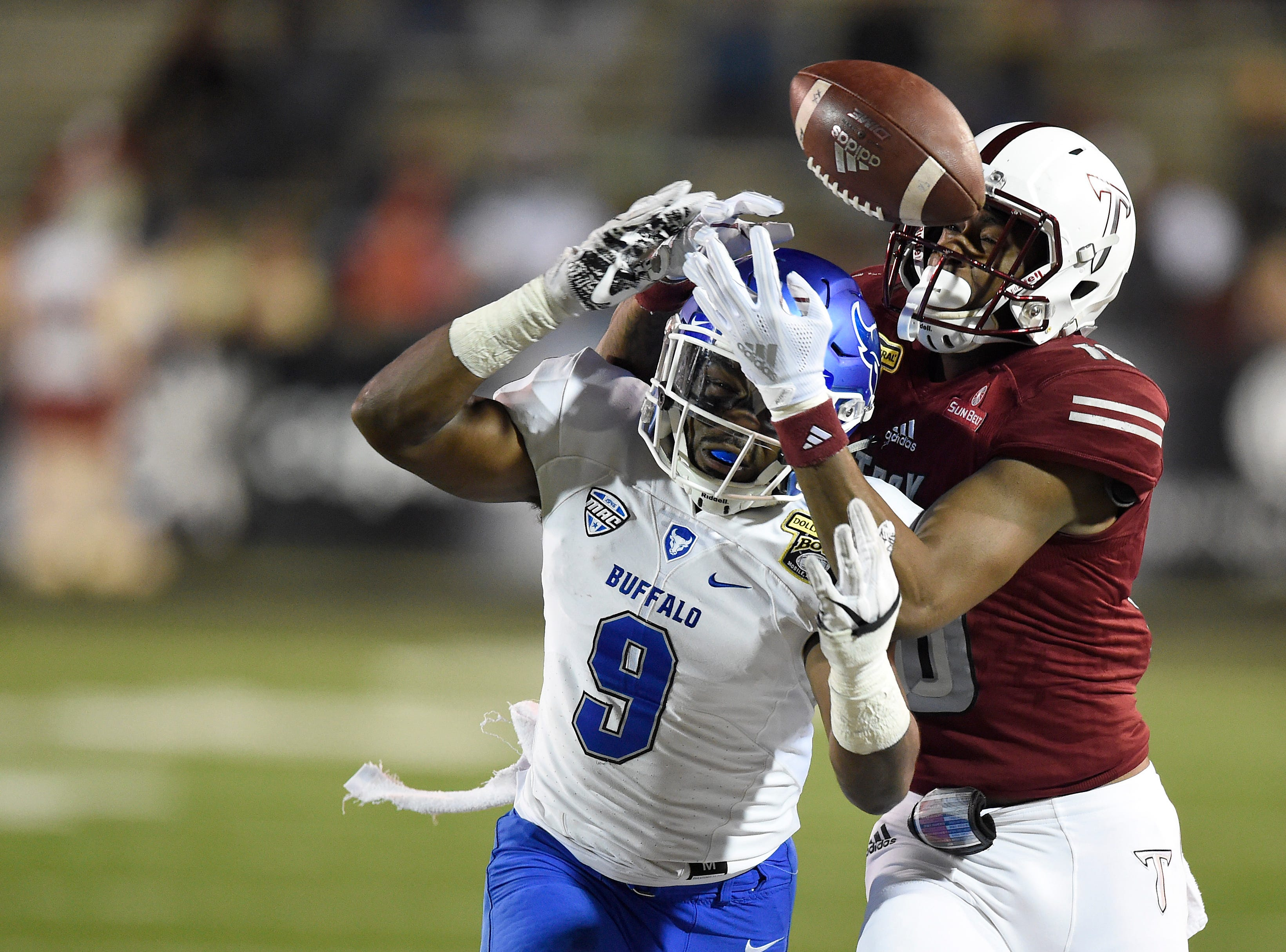 Buffalo Bulls cornerback Tatum Slack (9) breaks up an intended pass for Troy Trojans wide receiver Richard Hallman (10) during the third quarter of the Dollar General Bowl.