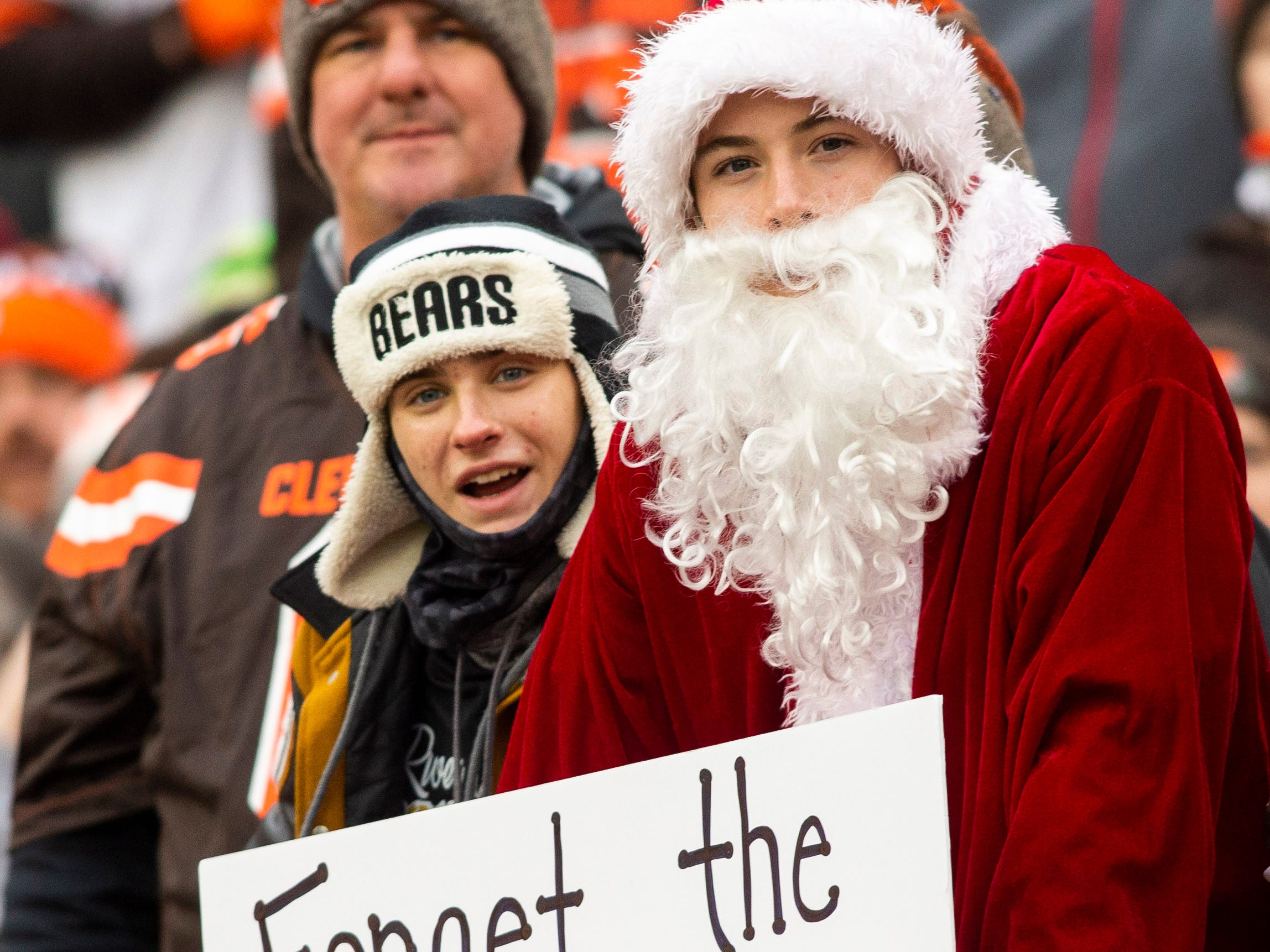 A Cleveland Browns fan holds a sign up during the second quarter of the game between the Cleveland Browns and the Cincinnati Bengals at FirstEnergy Stadium.