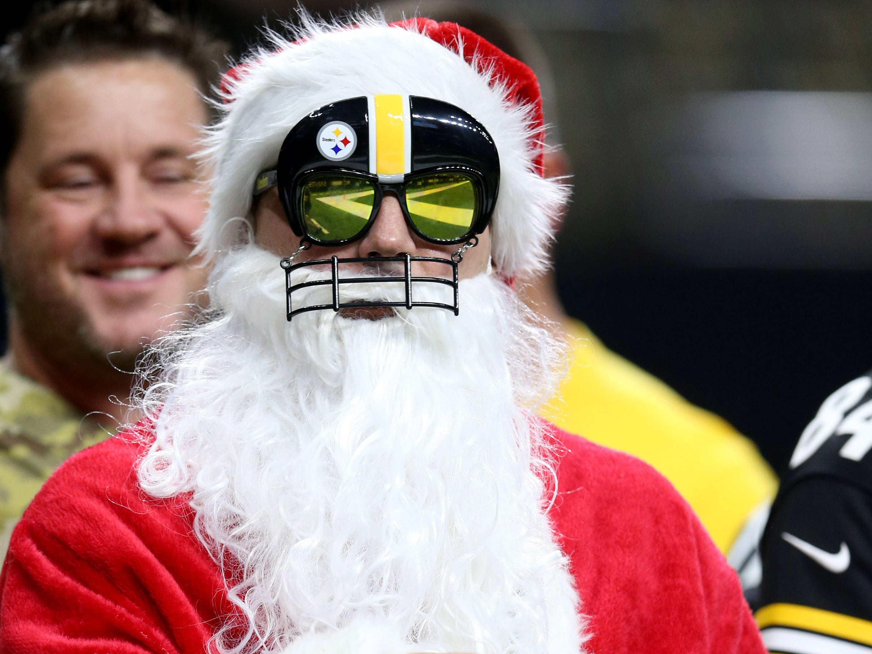 A Pittsburgh Steelers Santa looks on before the game against the New Orleans Saints at the Mercedes-Benz Superdome.
