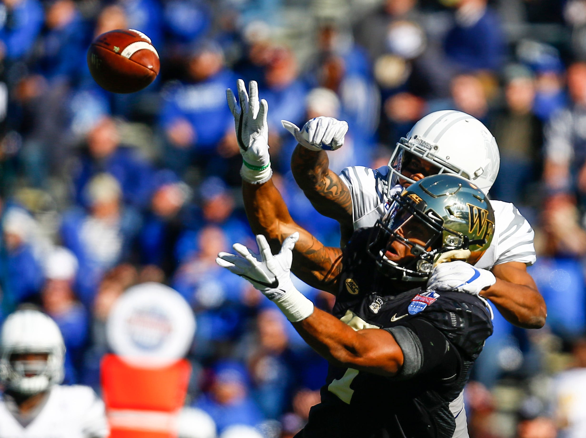 Wake Forest Demon Deacons wide receiver Scotty Washington (7) catches a pass as Memphis Tigers defensive back T.J. Carter (2) tries to defend during the first half of the Birmingham Bowl.