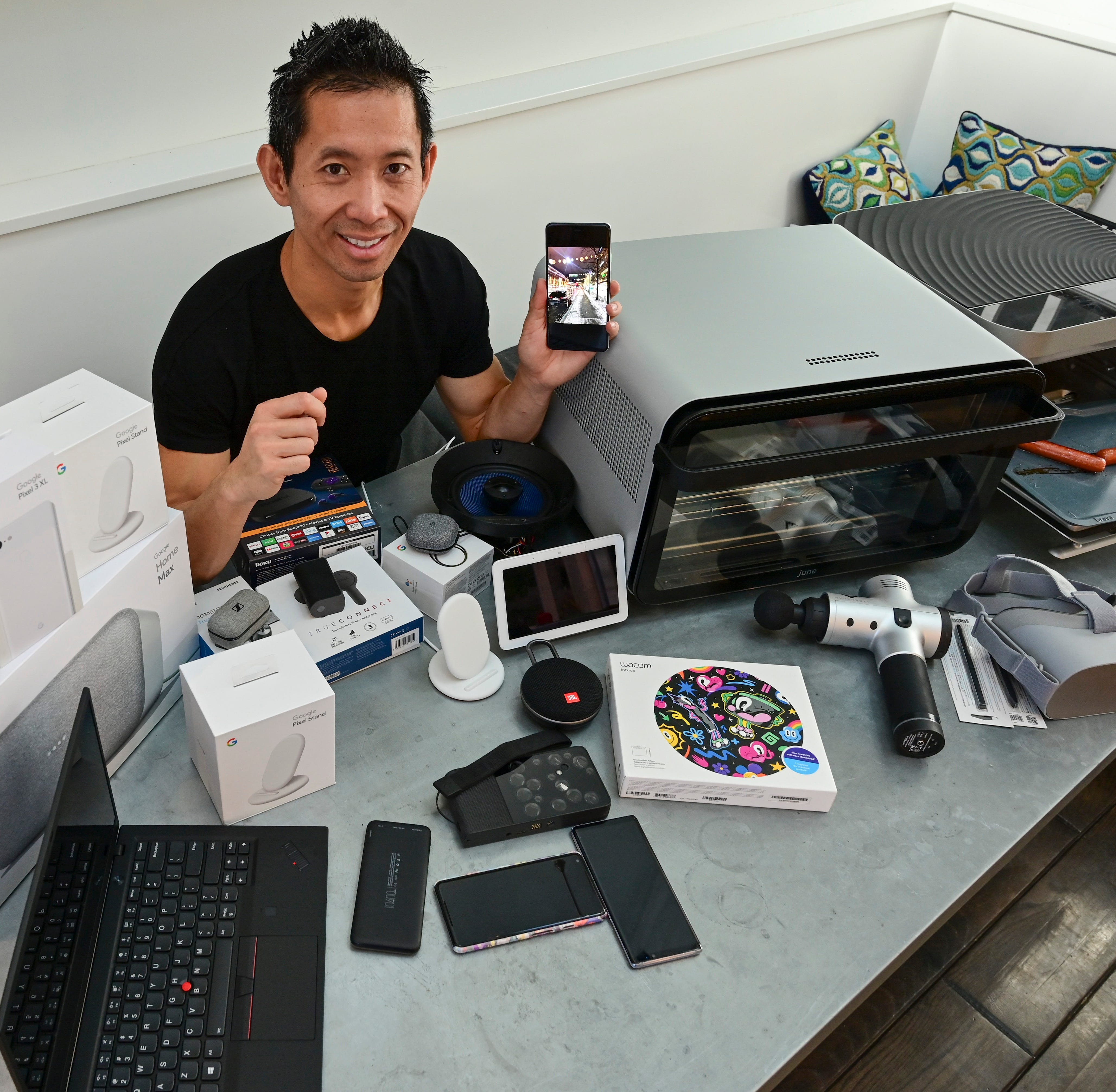 Peter Phan, tech investor, with some of his favorite tech gadgets from 2018.