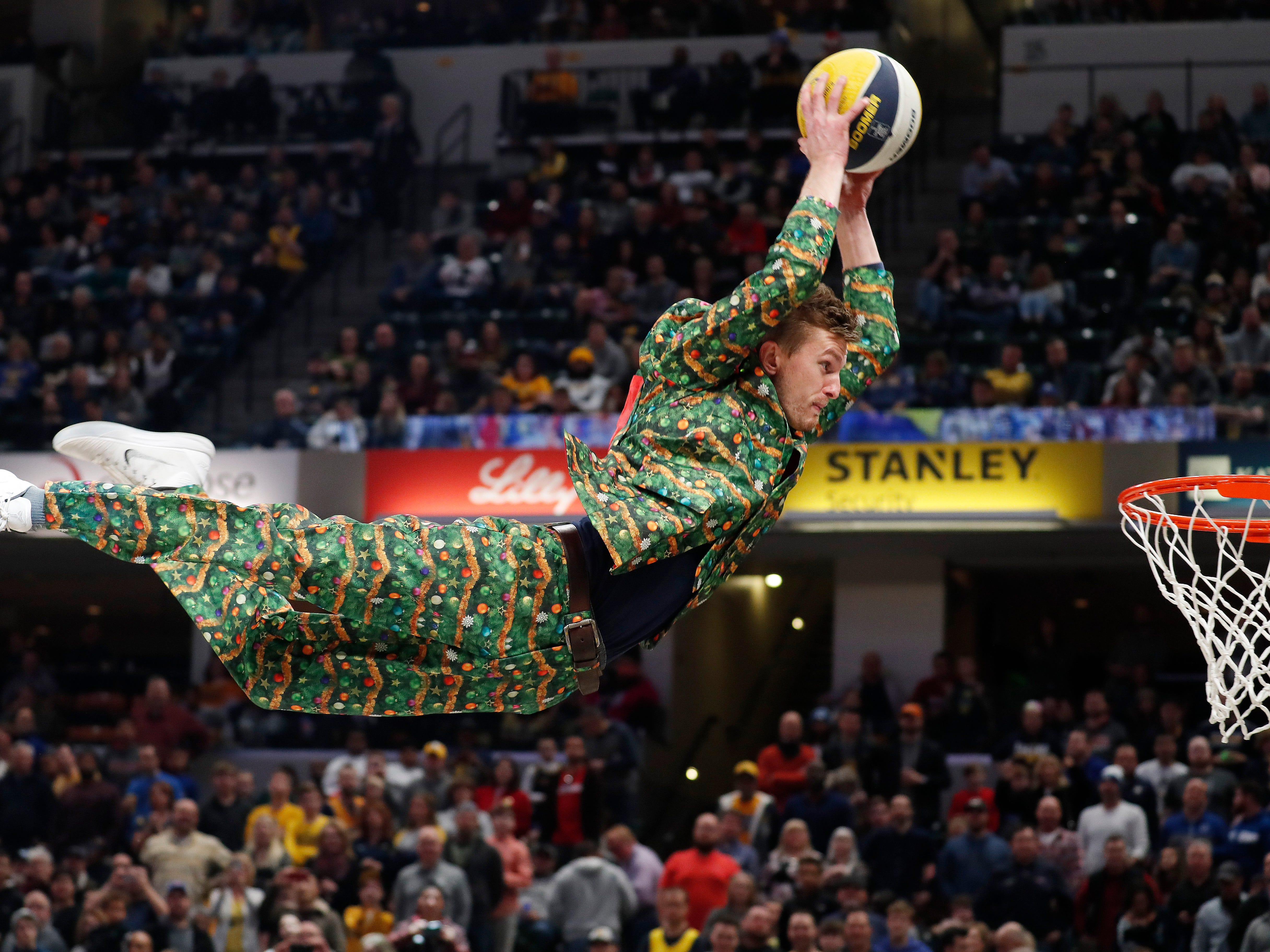 Dec. 23: A festively dressed member of the Pacers Power Pack entertains the crowd with an acrobatic dunk at Bankers Life Fieldhouse.