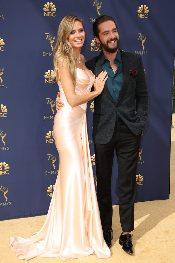 Heidi Klum and Tom Kaulitz, pictured here at the Emmy Awards, announced their engagement on Christmas Eve.
