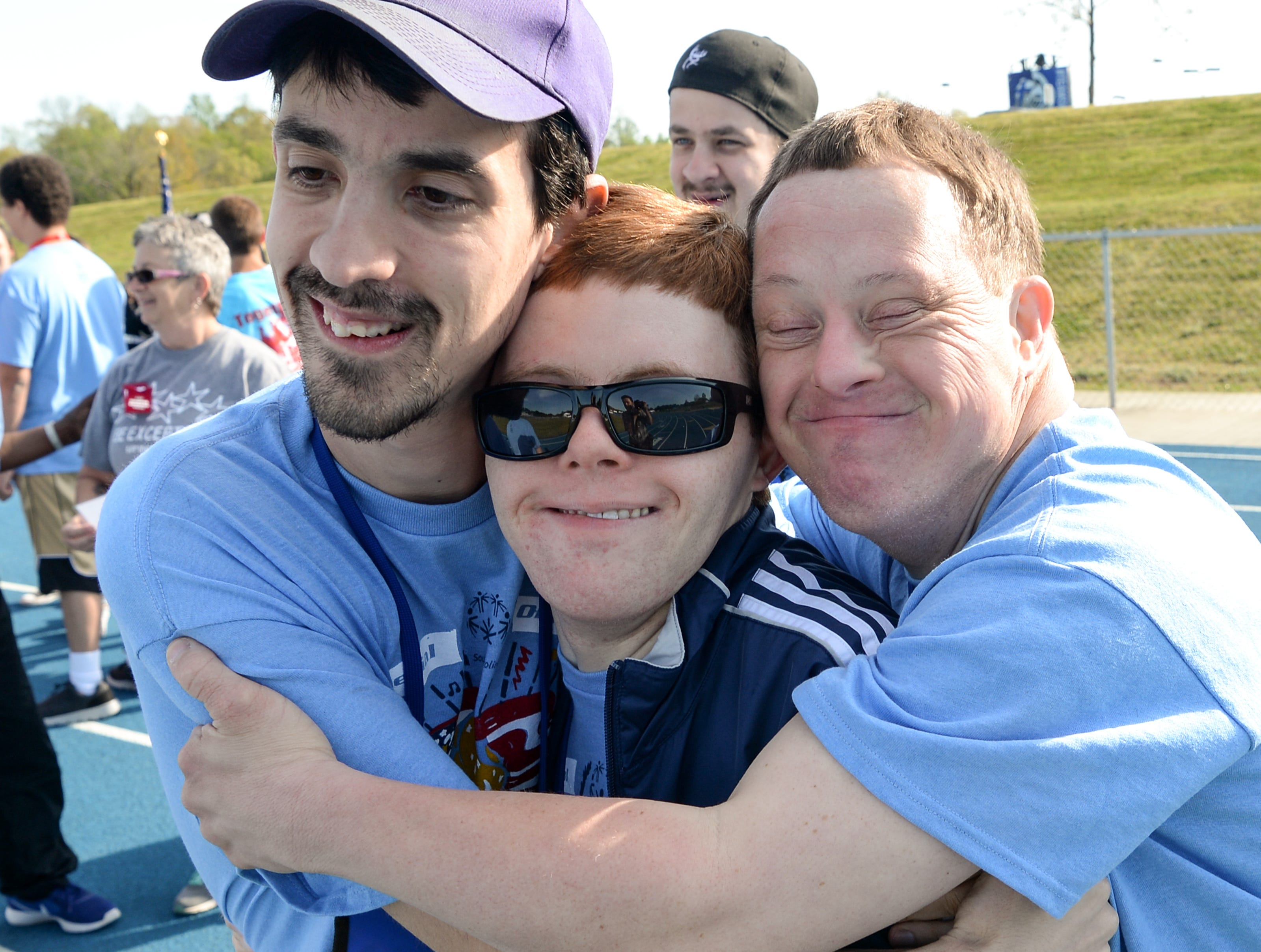 Devin Buccino, left, George Sands III, and Brad Hammond, from the Special Olympics South Carolina Area 14, give each other a group hug before Anderson CountyÕs Spring Games at Southern Wesleyan University on Wednesday. Children and adults from across Anderson County will compete in track and field events, which will include standing long jump, softball and tennis ball throw, 100 meter walk and run, 50 meter walk and run, 50 and 100 meter assisted walk and run, and wheelchair races. The parade of athletes will begin promptly at 9:30 a.m. followed by opening ceremonies and events. Events are set to conclude by 1 p.m. The Spring Games, with over 600 athletes at the Area 14 games, are around the state providing year-round athletic training and competition for 28,902 children and adults with intellectual disabilities.