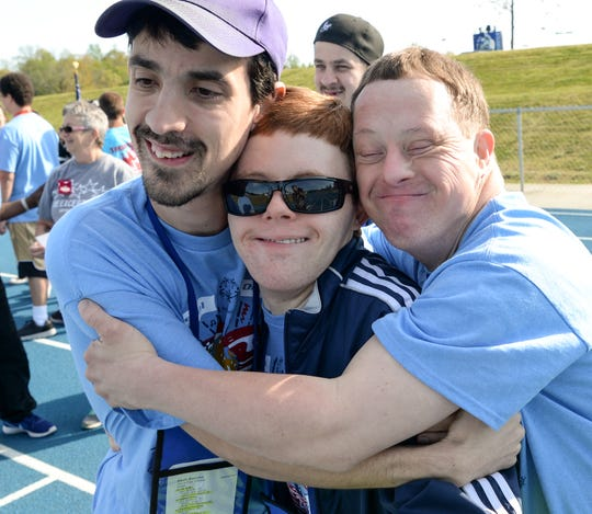 Devin Buccino, left, George Sands III, and Brad Hammond, from the Special Olympics South Carolina Area 14, give each other a group hug before Anderson CountyÕs Spring Games at Southern Wesleyan University on Wednesday. Children and adults from across Anderson County will compete in track and field events, which will include standing long jump, softball and tennis ball throw, 100 meter walk and run, 50 meter walk and run, 50 and 100 meter assisted walk and run, and wheelchair races. The parade of athletes will begin promptly at 9:30 a.m. followed by opening ceremonies and events. Events are set to conclude by 1 p.m. 